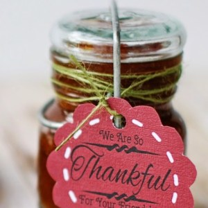 crockpot apple butter packaged for gifts in little canning jars