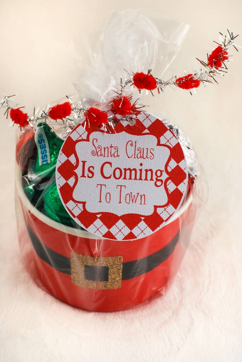 Christmas gift wrapped with a clear sandwich bag and ribbon with a free printable gift tag