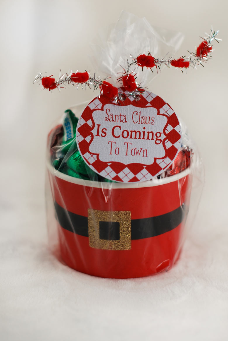 A santa belly gift cup filled with candy with a printable label to give to a friend or coworker