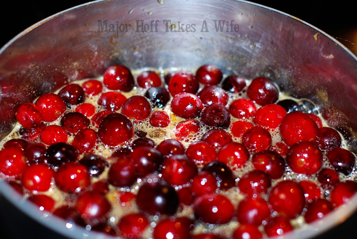Cranberries boiling on stovetop
