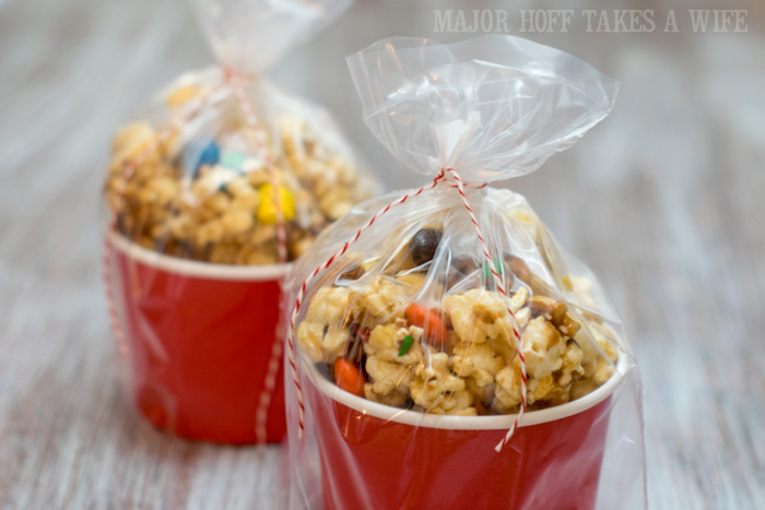 Movie Munch Snack Mix wrapped for gifting. It's time for a Family Movie Night! You won't want to miss this recipe for the fabulous Movie Munch! Can you guess what the secret ingredient is? Post also shows how to create your own Guardians of the Galaxy Gift Basket, perfect for your favorite super hero fans, or for a Finals Survival kit. #OwnTheGalaxy #CBias #sp #ad