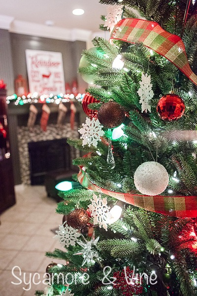 Use plaid ribbon on a plaid country Christmas inspired tree.