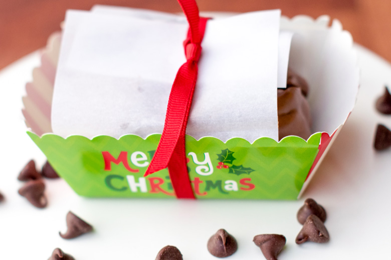 chocolate peanut clusters for gift giving wrapped up in a disposable Christmas paper mini loaf pan