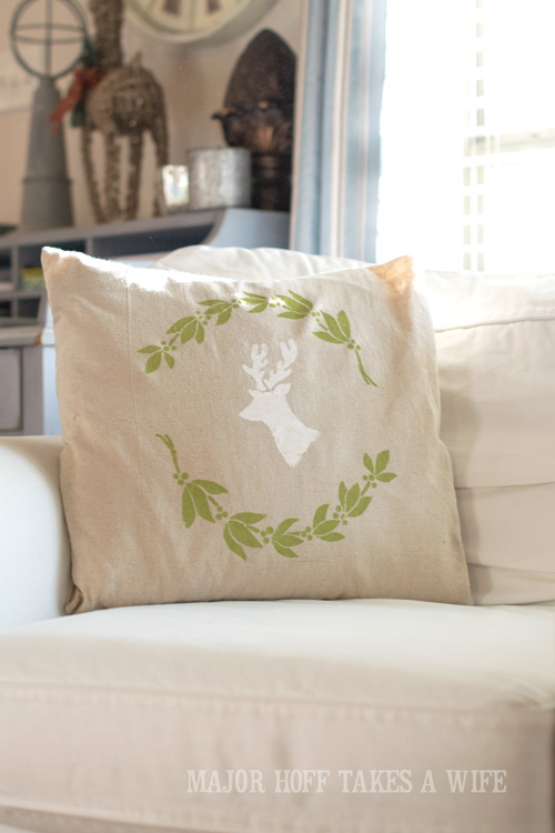 Use a blank pillow cover and stencils to make a holiday pillow. Looking for a way to bring Creativity into your Holiday Decor? Use easy to find items like pillow covers or dish towels, along with stencils to decorate your home for the Holidays. Enjoy crafting your own decorations this Christmas! #Christmas #Holidays #crafts #HolidayIdeas