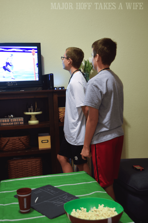 Football video game playing party. Looking for a fun party for your teenage boy? Why not throw a Football video game party? Easy ideas for how to entertain kiddos during the Big Game. Features DiGiorno pizza, personalized football cups, free printable lanyards, and an incredible recipe for football shaped ice cream sandwiches! #GameTimeMVP #CollectiveBias #ad