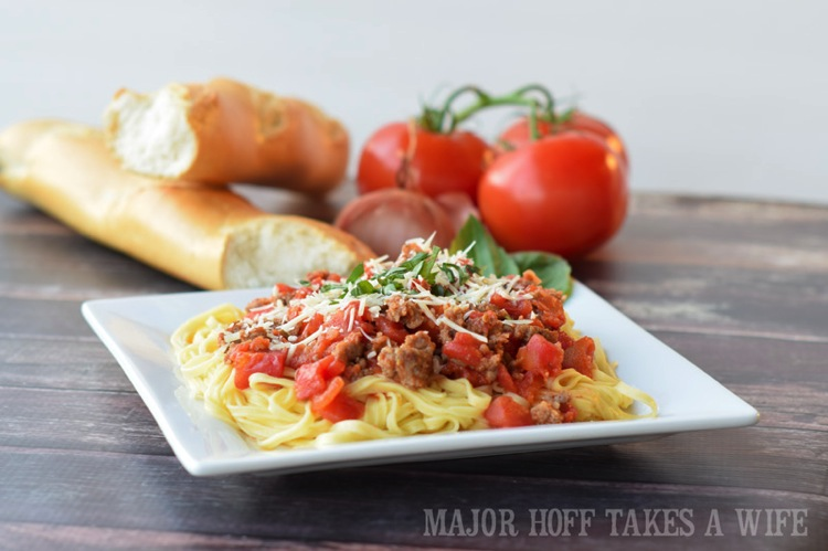 Sausage in marinara sauce. The perfect way to learn how to make homemade spaghetti sauce! In this learn to cook series, you will be taught everything you need to know to make the most scrumptious Italian Sausage Spaghetti Marinara Sauce. Part of the #TeachMeToCookSeries this meal is done and on the table in less than 30 minutes! WOW! #Pasta #spaghetti #homemade #Learntocook