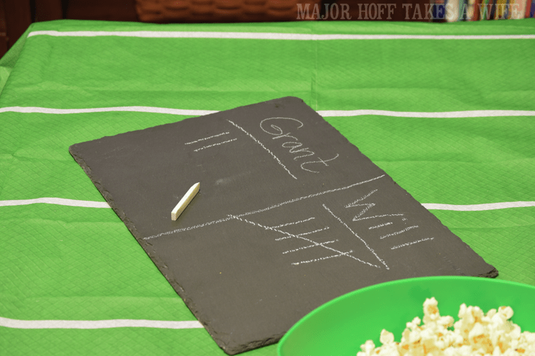 Use slate as chalkboard. Looking for a fun party for your teenage boy? Why not throw a Football video game party? Easy ideas for how to entertain kiddos during the Big Game. Features DiGiorno pizza, personalized football cups, free printable lanyards, and an incredible recipe for football shaped ice cream sandwiches! #GameTimeMVP #CollectiveBias #ad