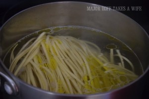 Boiling noodles for homemade spaghetti sauce