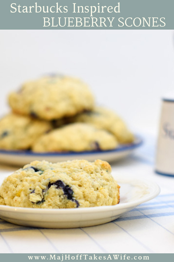 A melt in your mouth recipe for blueberry scones. Inspired by Starbucks in house version, this blueberry scone with hints of lemon and a crunchy sugary top will delight everyone. Serve during High Tea, or just as a mid afternoon snack. Perfect along side tea or coffee, or as a stand alone blueberry dessert. You won't believe how easy these are to make! Never made scones before? Never fear, this includes a step by step tutorial on how to make scones. #HighTea #blueberries #Starbucks #scones #dessert via @mrsmajorhoff