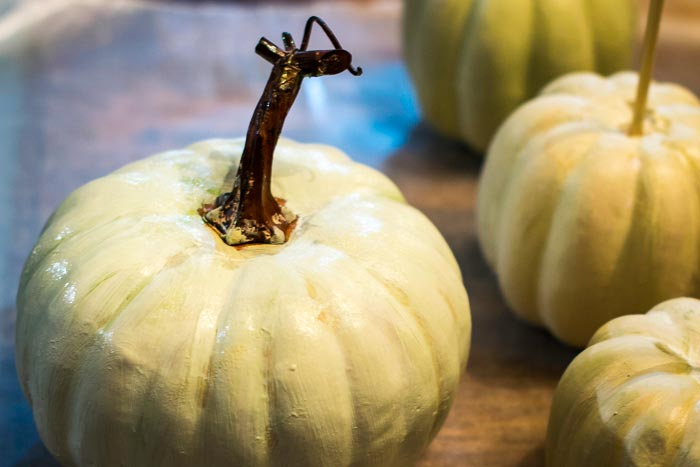 ideas for fall crafting, painting inexpensive styrofoam pumpkins