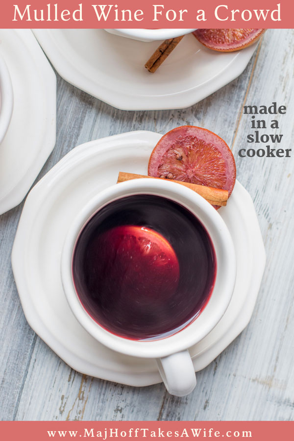 This winter mulled wine recipe is a cinch to make in a slow cooker. Featuring fresh oranges, apple slices and cinnamon it will be a crowd favorite! So grab your crockpot, follow the easy recipe and have this German inspired drink at your next holiday party! Perfect for fall all through Christmas! #mulledwine #Christmasdrinks #fallbeverages via @mrsmajorhoff