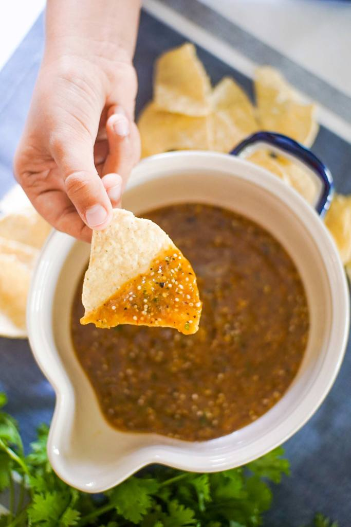 Learn how to make easy homemade tomatillo salsa at home. Tips and tricks to pick the right ingredients and make restaurant quality salsa at home!