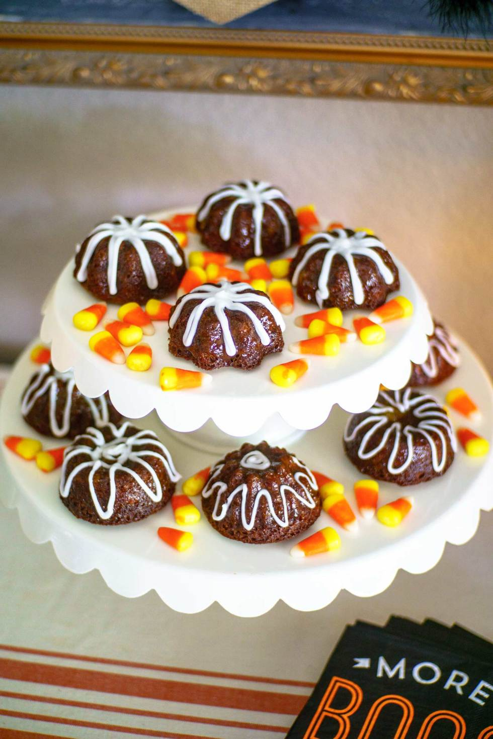These sweet little gingerbread cakes are adorable and easy to make in a mini bundt pan. Perfect for all year round, these feature an optional peach glaze. @MrsMajorHoff for @worldmarket #worldmarket #ad #worldmarkettribe #WMHalloween
