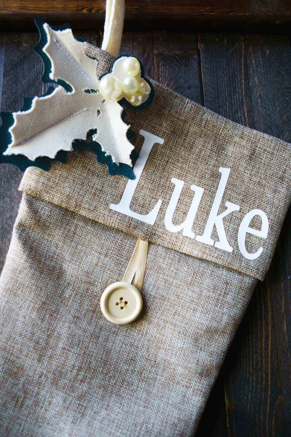 Level up a store bought stocking with homemade holly from leather and canvas on a Cricut machine. Add fonts to make it a personalized Christmas stocking!Level up a store bought stocking with homemade holly from leather and canvas on a Cricut machine. Add fonts to make it a personalized Christmas stocking!