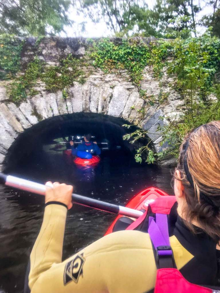 kayaking under the bridge by Ross castle