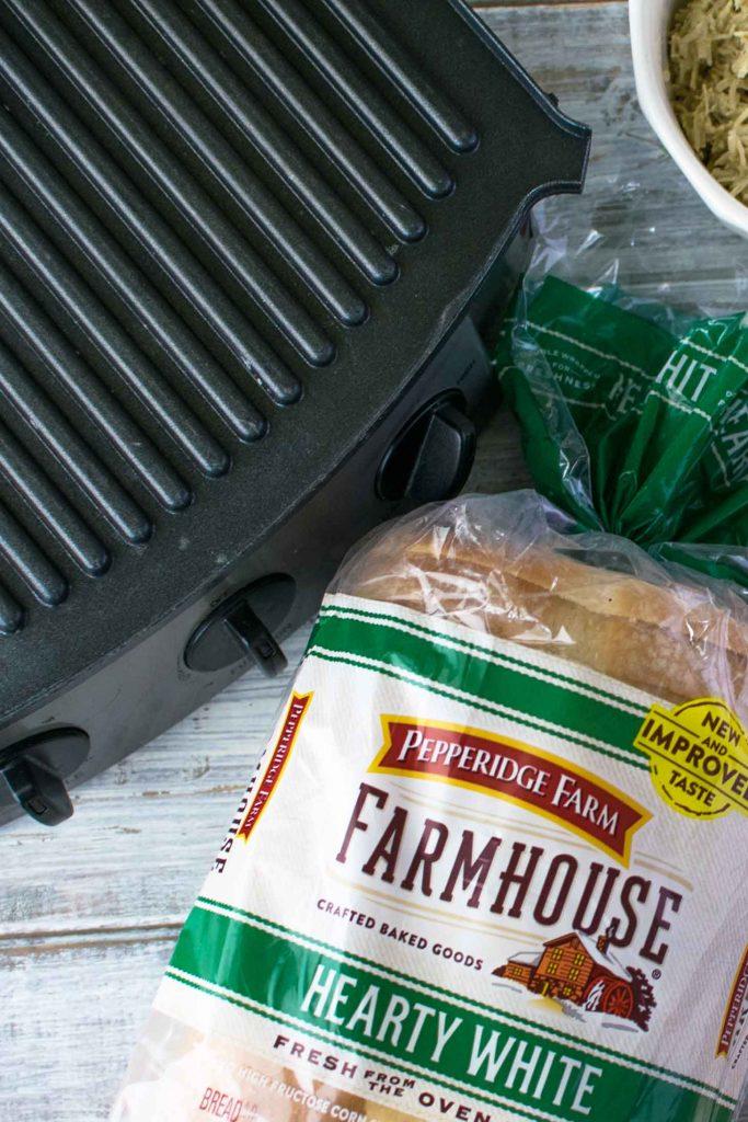 Pepperidge farm farmhouse hearty white bread by a panini press