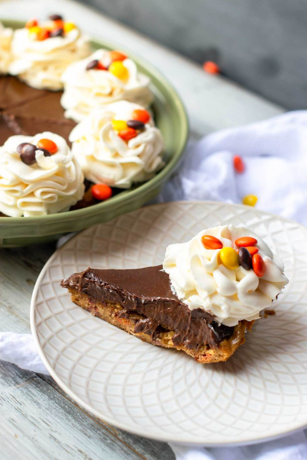 Reese's pie is a simple peanut butter pie with stabilized whipped cream flowers and Reese's Pieces