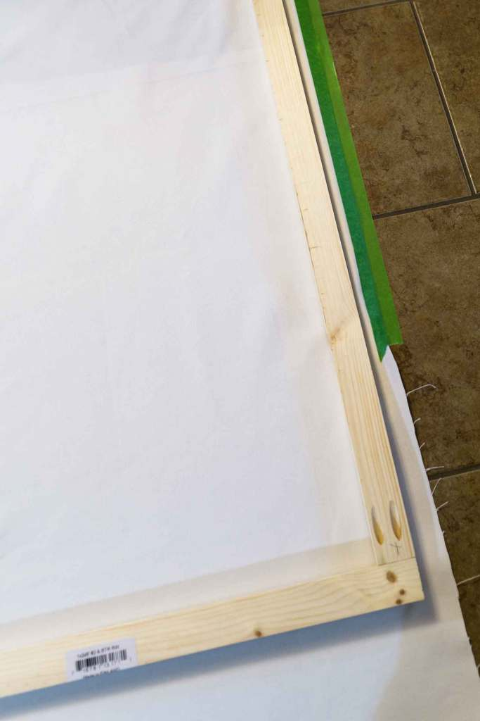 Use Frog tape to stabilize your canvas fabric before stapling it to your wooden frame