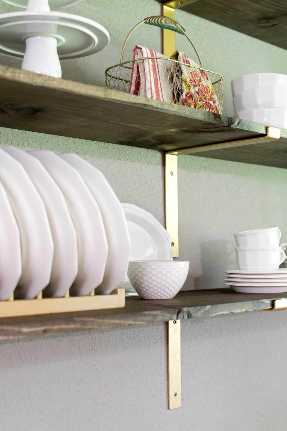 white dishes on rustic shelves in a breakfast room