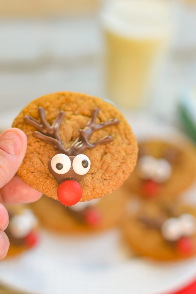 Reindeer cookies are made with a classic gingerbread dough, piped antlers and a candy kiss face.
