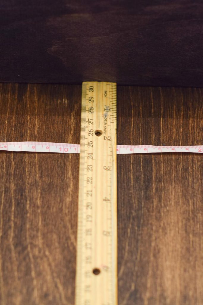 Using a ruler and a measuring tape to determine where cup hooks go on a mug shelf