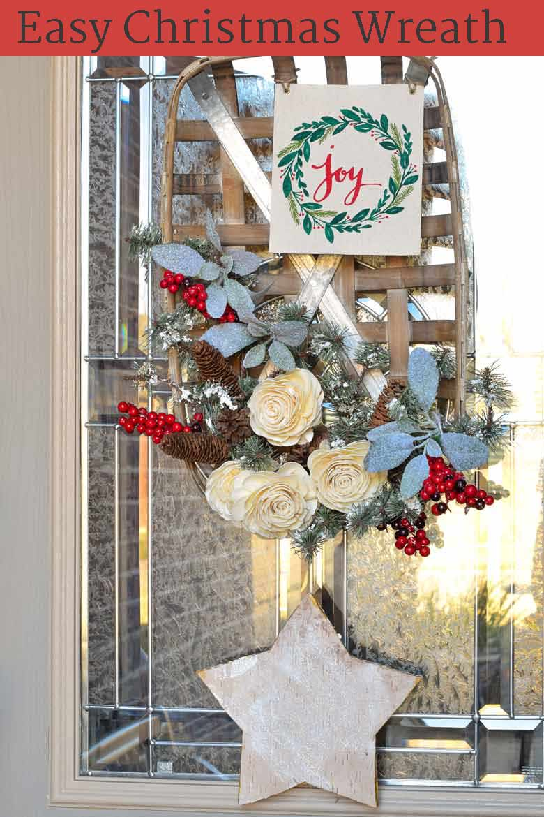 A winter wreath on your front door is a cozy welcome to all your guests. This tutorial will show you how to make a basket wreath for Christmas and beyond! See the step by step process on how to assemble this inexpensive wreath, how to make it perfect for the holiday season, and how to modify it to be used all winter long! #Christmas #wreath #winter #christmasdecor