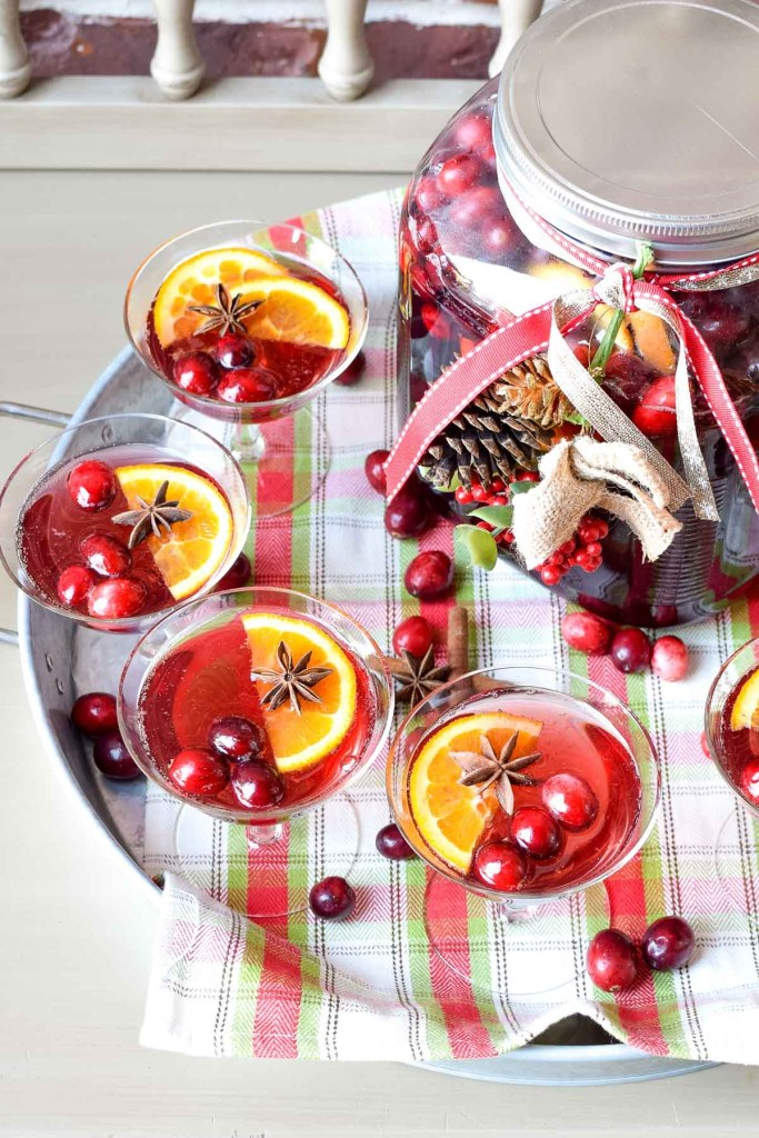 Greet your holiday party guests with a large container of ginger ale and cranberry punch