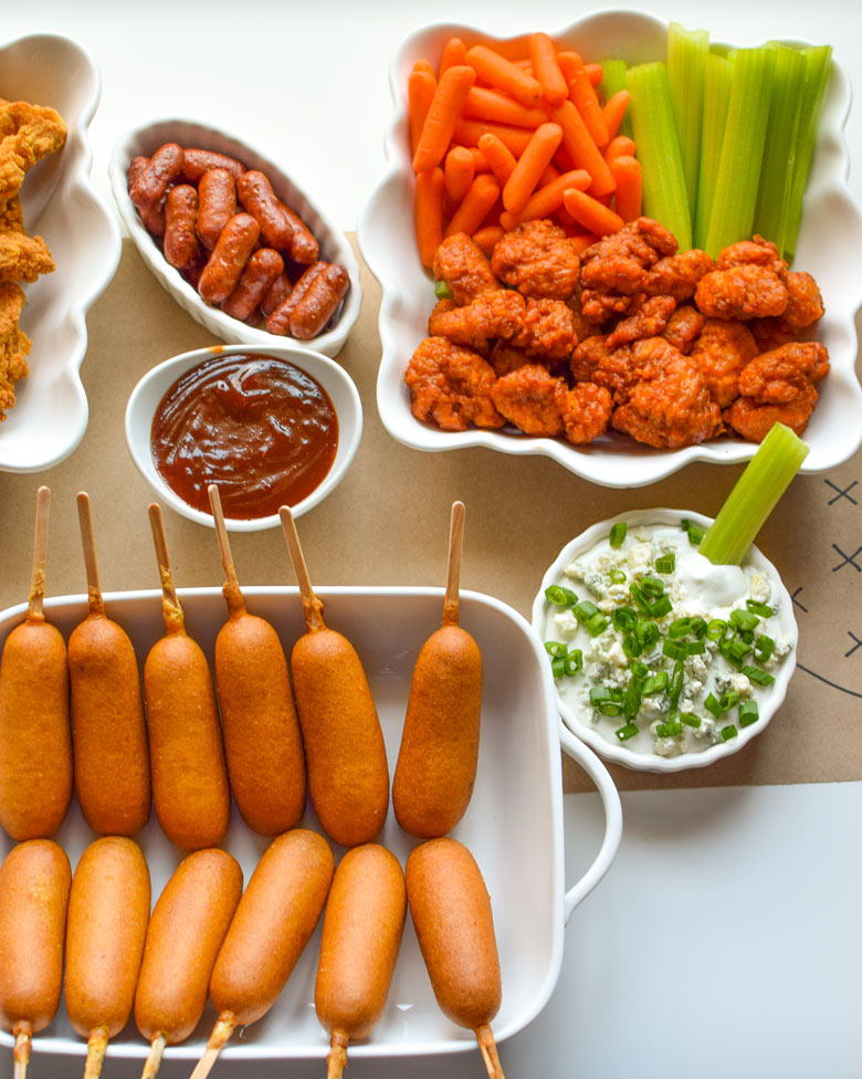 Game day favorites include veggies, buffalo chicken, blue cheese, and lil' smokies