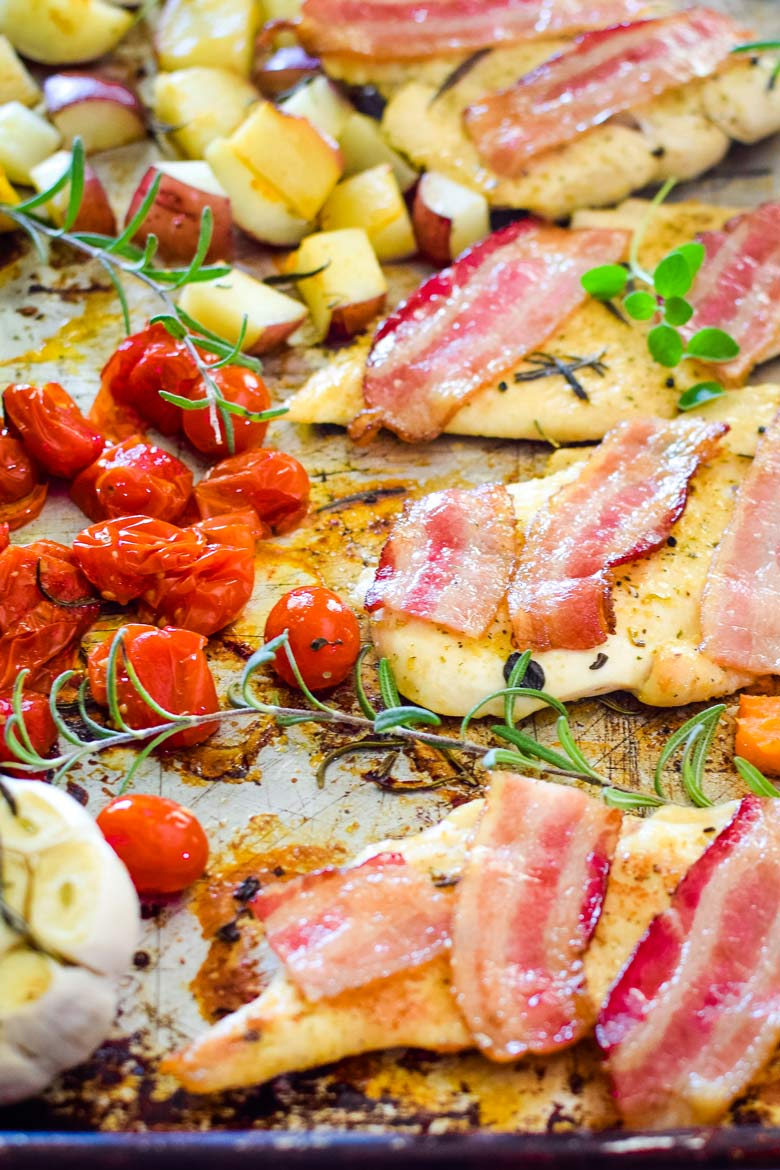 a simple tray bake dinner of bacon chicken and vegetables