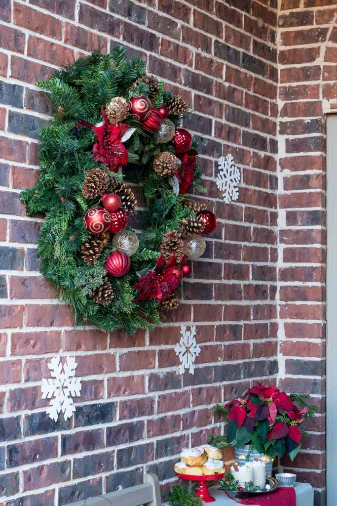 Large holiday wreath on brick wall
