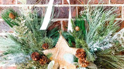 large metal wreath full of Christmas greenery