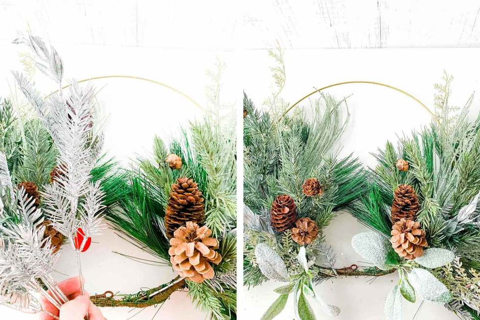 adding accents like pinecones and glitter stems to a wreath