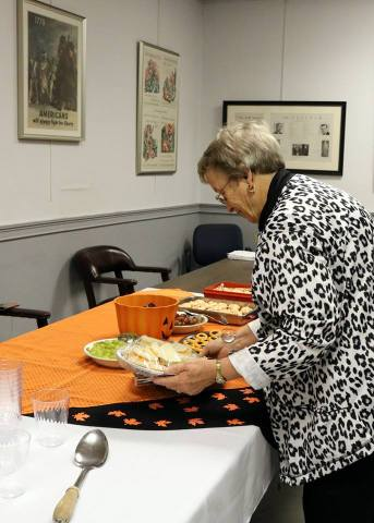 Mary Ford at meeting snack table