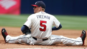 ATLANTA, GA - JUNE 30: First baseman Freddie Freeman #5 of the Atlanta Braves sits on the ground after a stretch that narrowly missed closing out a double play during the game against the Arizona Diamondbacks at Turner Field on June 30, 2013 in Atlanta, Georgia. (Photo by Mike Zarrilli/Getty Images)