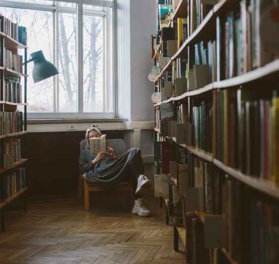 photo of woman reading book