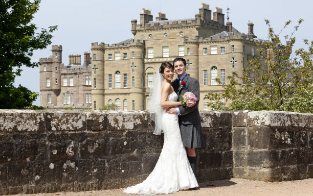 Couple In Front Of Castle