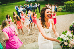 bride about to toss bouquet