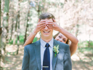 Bride covering groom's eyes for first look