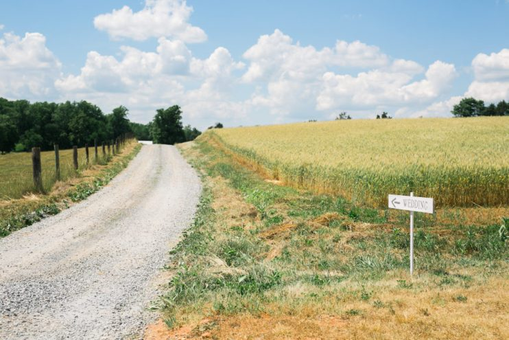 Landscape country photo with a wedding direction sign for vendors