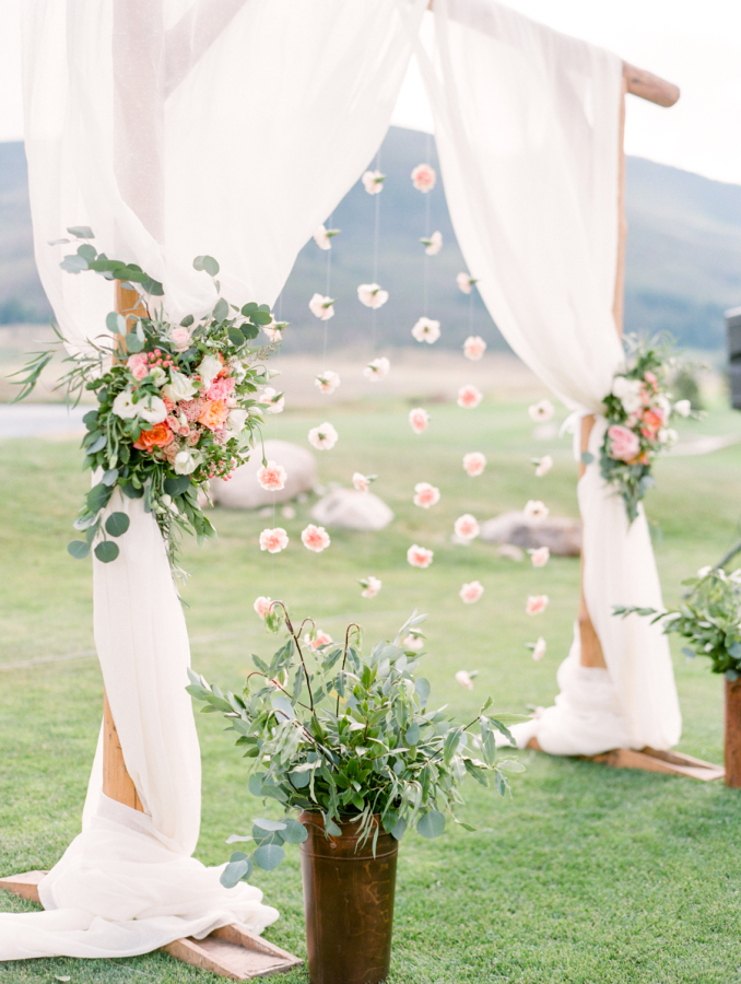 floral archway outdoor wedding