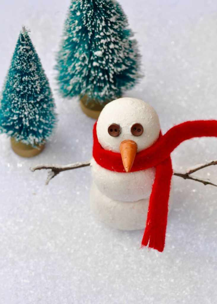 DIY Snowman Decoration Craft made from clay. SO cute and fun to make with the kids!