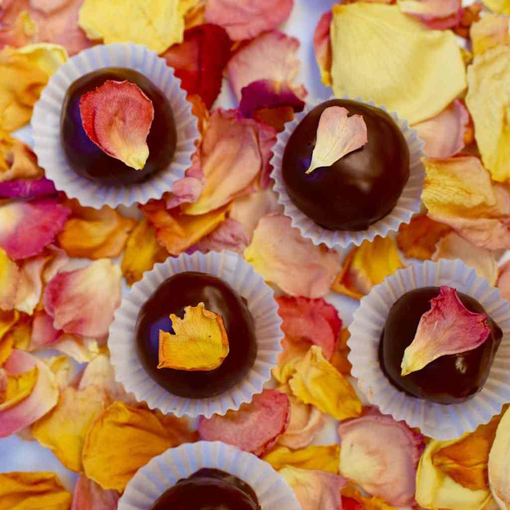 Edible rose petal flowers on chocolate truffles