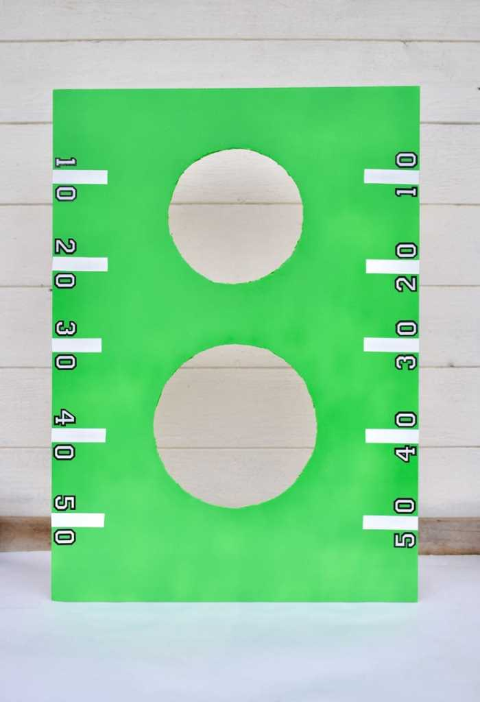 DIY Football Toss Game for Kids. So easy and fun for kids to play during the big game!