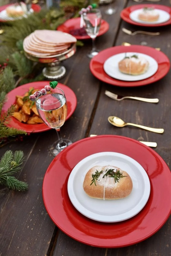 Holiday dinner party on rustic farmhouse table
