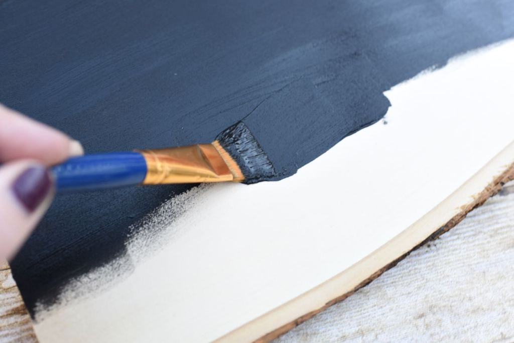 Paint the wood sign with chalkboard paint