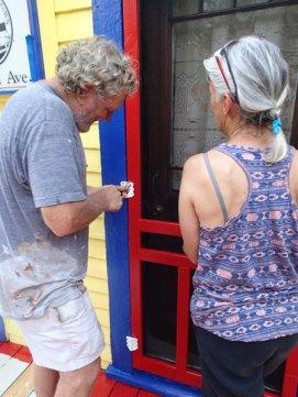 Day 5: Greg and Karin hang the screen door.
