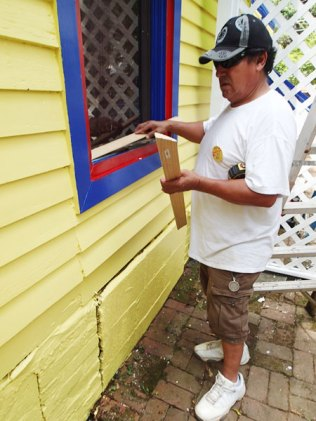 Day 5: Chavez works on the window sill.