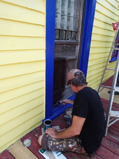 Day 3: Paul puts a sealer on the front door.