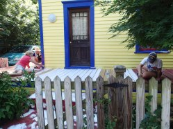 Day 4: Melody, Ro, and Emanuella start priming the porch.