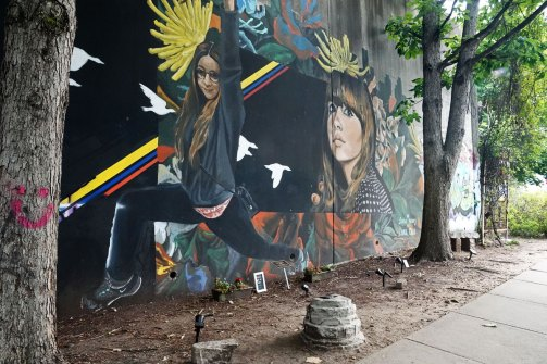 Memorial to Laura Calle. Several of the murals on the CSX wall commemorate loved ones.
